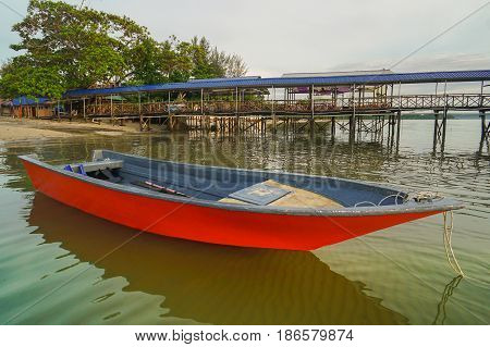 Fishing boat with the sunrise in the sea in the fisherman village in Labuan island,Malaysia.