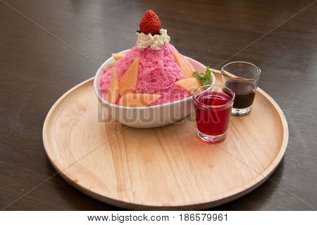 ice milk Korean dessert bingsu with strawberry and sauce