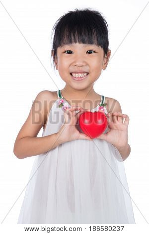 Asian Little Chinese Girl Holding Red Heart in isolated White Background