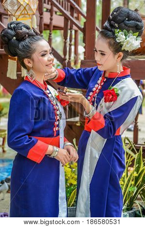 NAKORN PHANOM THAILAND - FEBRUARY 14 2015: Thai northeastern Phutai dancers with traditional costume in Phutai world event day in Renunakorn of Nakorn Phanom Thailand.