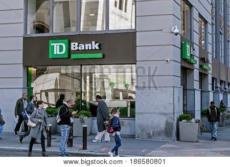 New York May 08 2017: People walk by a TD Bank retail location in Manhattan.