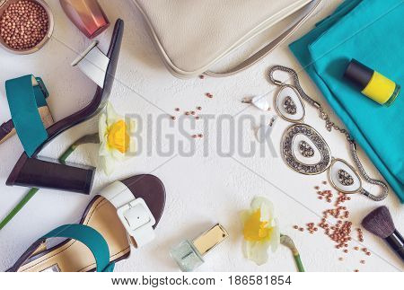 flat lay Women's shoes and accessories collage. Beauty and fashion background. Top view with copy space. Toned