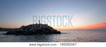 Sunrise over Breakwater / jetty for the Puerto San Jose Del Cabo harbor / marina in Baja Mexico B C S