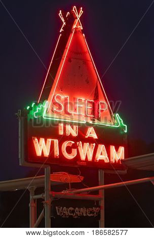 Cave City KY/USA - July 25 2015: The Sleep In A Wigwam neon sign at night on July 25 2017 in Cave City Kentucky.