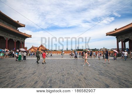 Beijing China - August 06, 2014: Tourists visits Forbidden city. Perspective view from the old city to the modern city