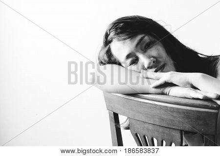 Depress And Hopeless Woman Sitting On Chair