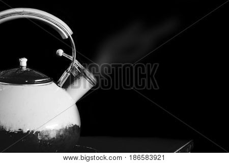 Kettle Boiling With Steam On Black In White Tone