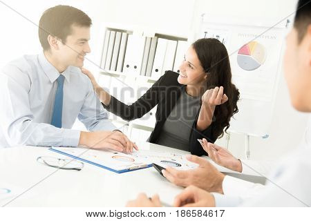 Businesswoman listening and paying attention to her colleague in the meeting