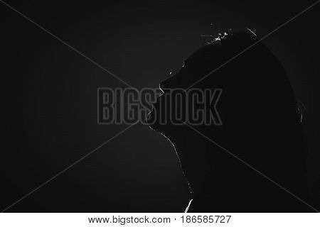 Silhouette Of Depress Woman Standing In The Dark With Light Shine Behind, White Tone