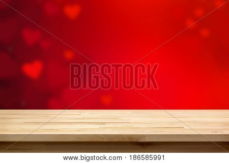 Wood table top on blur red heart abstract background love and Valentine's day background concept