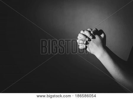 Praying Woman Hand In The Dark ( Praying In Secret Room Concept )