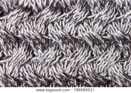 Black and white knitting fabric texture background or knitted pattern background. Knitting or knitted background close up view. Knitting pattern or knitted pattern for design