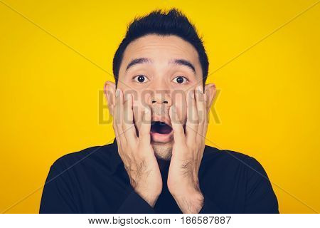 A man expressing shocked and scared face feeling and emotion concept - vintage tone effect