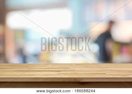 Wood table top on blur background of coffee shop interior - can be used for display or montage your products