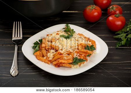 Penne pasta with tomato sauce and cheese