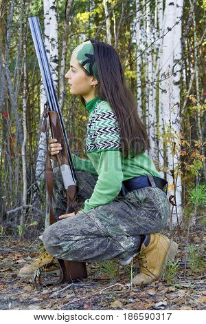 The girl hunter in ambush in Siberian taiga