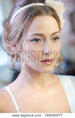 Closeup portrait of young bride in full makeup.