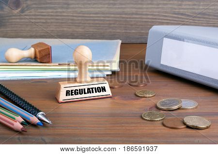 Regulation. Rubber Stamp on desk in the Office.