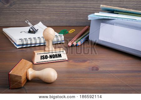 Iso-Norm. Rubber Stamp on desk in the Office. poster