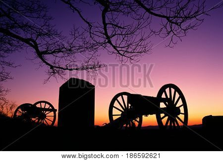 Relics from the civil War sit in the sunset