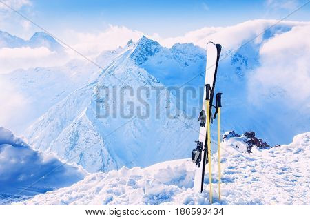 Winter mountains and ski equipment in the snow. Skiing winter sport