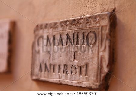 marble nameplates on the wall in the Italian courtyard