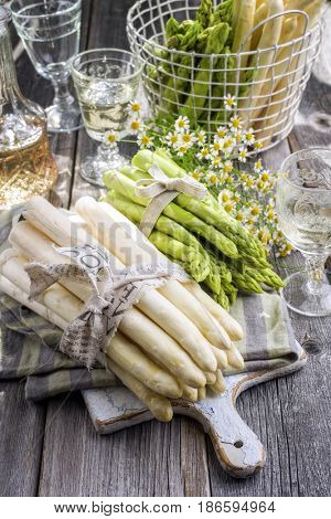 Row green and white Asparagus as close-up on a cutting board