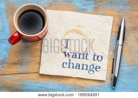 I want to change declaration - handwriting on a napkin with a cup of coffee