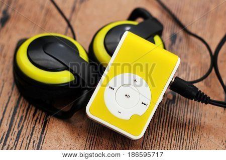 Yellow Music Player And Beautiful Overhead Headphones