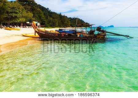 Long tail boat moored at the beach in Thailand