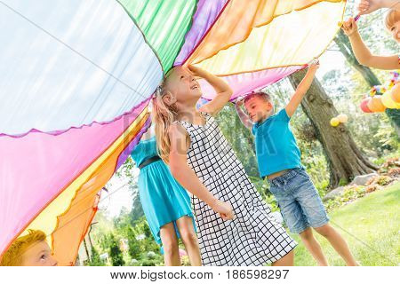 Kids playing in games on a birthday garden party