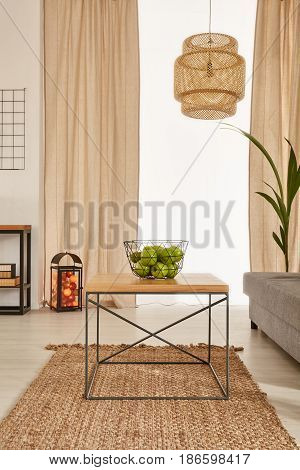 Wooden Coffee Table And Rattan Lamp