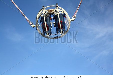 A huge slingshot fires a capsule with people, attraction in the Park