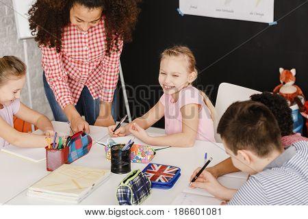 Smiling Children And Female Teacher