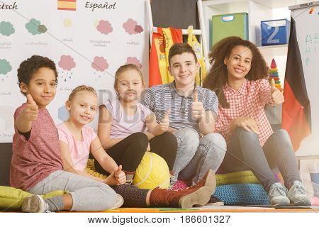 Teacher And Kids With Thumbs Up
