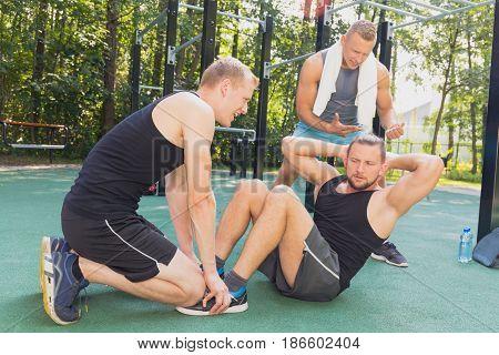 Men Having Calisthenics Workout