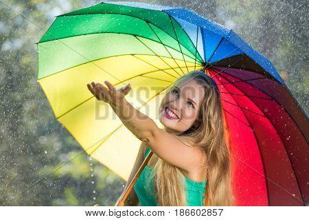 Blonde Girl Checking For Rain