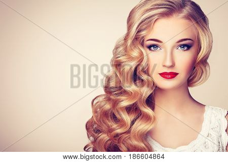 Fashion portrait of young beautiful woman with jewelry and elegant hairstyle. Blonde girl with long wavy hair. Perfect make-up. Beauty style model