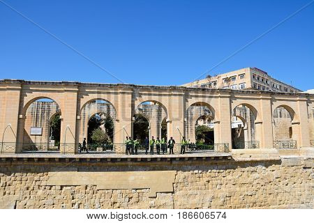 VALLETTA, MALTA - MARCH 30, 2017 - Tourists looking at the view through arches in Lower Barrakka gardens Valletta Malta Europe, March 30, 2017.