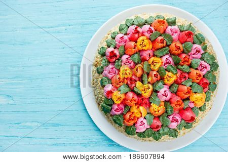Beautiful birthday cake on blue background top view
