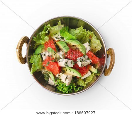 Vegan dish, fresh salad from grapefruit, tofu and avocado in copper bowl top view isolated on white background. Indian restaurant healthy meals. Eastern local food.