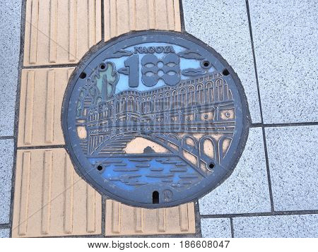 Nagoya, Japan - February 19, 2017: A manhole cover of Nagoya city, Aichi Prefecture, Japan. The ancient bridge and the river were engraved on a manhole cover.