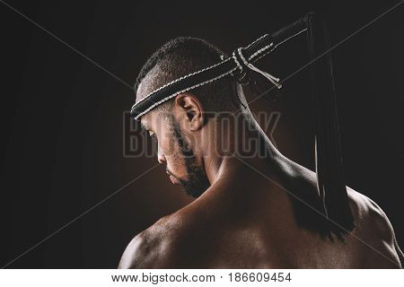 Back View Of Shirtless Muay Thai Athlete Standing In Studio, Action Sport Concept