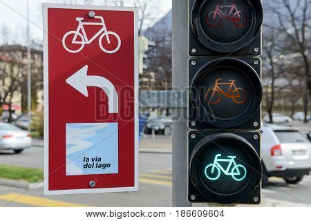 Lugano, Switzerland - 13 Aprile 2016: Traffic light for cyclists on a cycling path