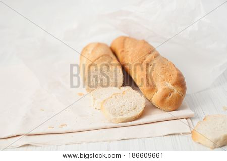 Two French Baguette On A White Table