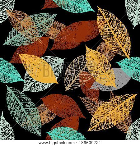 A seamless background pattern of vector skeleton leaves in teal blue and rusty brown on black, autumnal repeat print