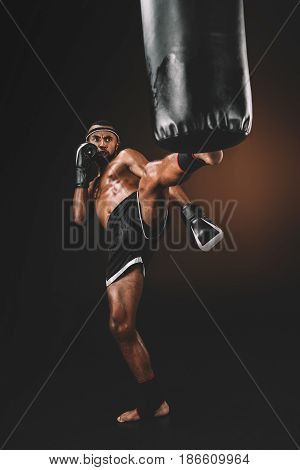 Angry Muay Thai Fighter Training With Punching Bag, Action Sport Concept