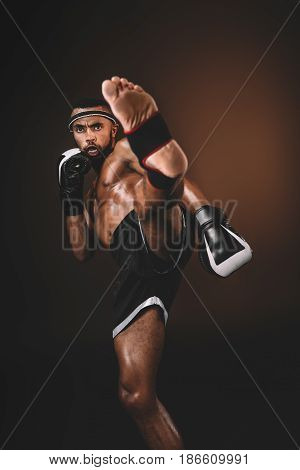 Studio Shot Of Focused Training Muay Thai Fighter, Fight Club Concept