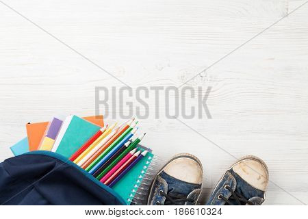 School supplies on wooden table. Back to school concept with copy space