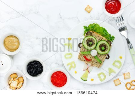 Food art - sandwiches for dad creative idea for a snack on Father's Day top view